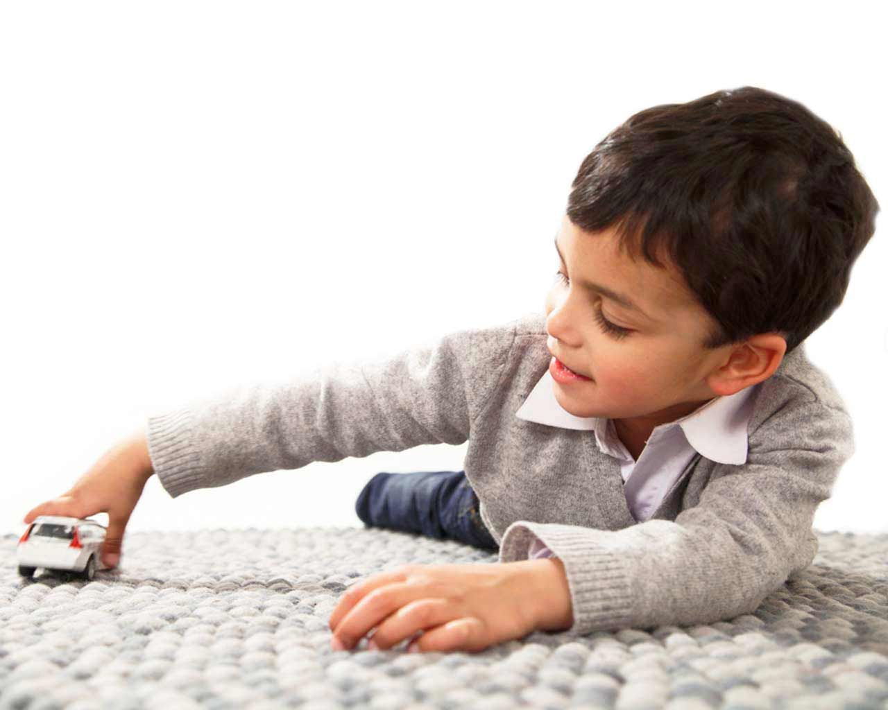 boy play with car on rug soft carpet