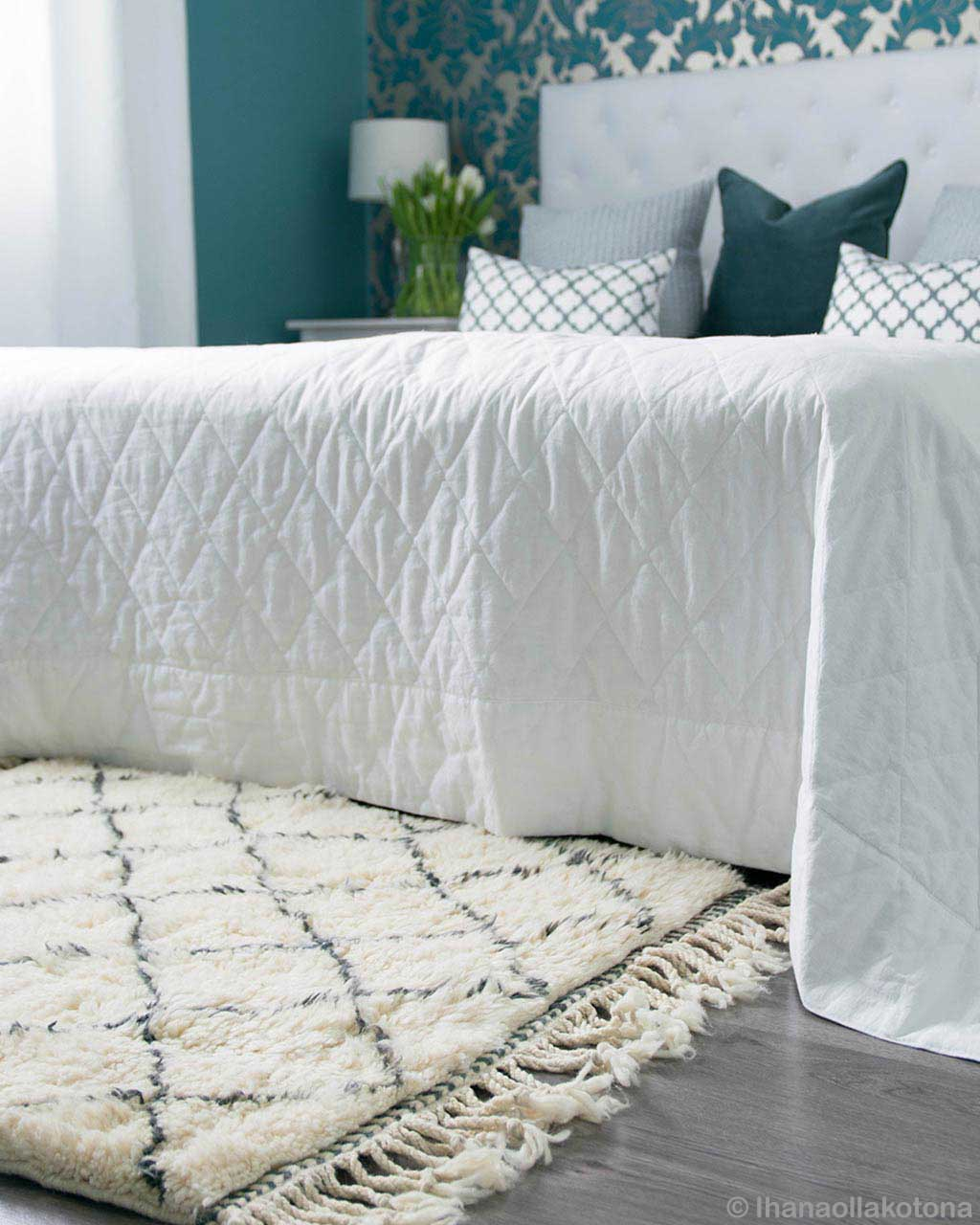 bed with white bedsheet and pillows contemporary rugs usa