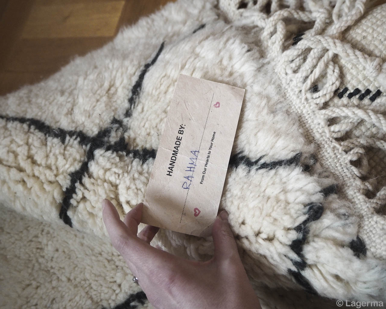 holding the card with hand asian traditional rugs