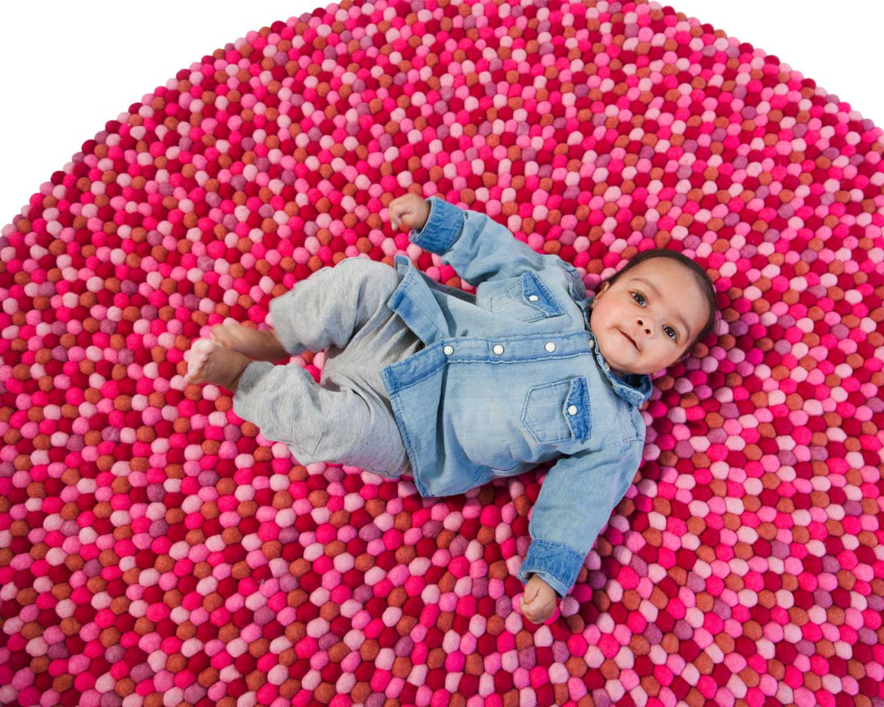 danish design felt ball carpet with baby in jeans