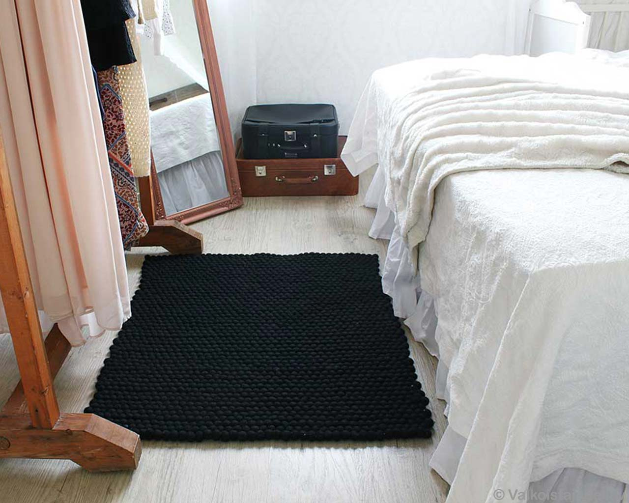 mirror black carpet suitcase white bed 1